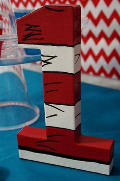 Number decoration at a Dr. Seuss Cat in the Hat birthday party! See more party planning ideas at CatchMyParty.com!