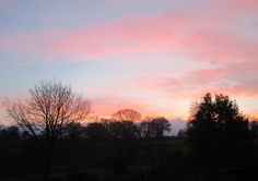 December sunrise in Shropshire photographed from the bedroom window by Anthony J Sargeant