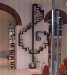 A treble clef bookcase? Need. Music and books.  Great for that large, blank wall.