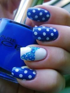 Blue with white polka dots and an accented nail with a bow!  Cute!