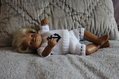 I have a lovely early 1970's sexed baby boy doll for sale in good clean condition. He is dressed in a new hand knitted outfit, whichconsists of a nautical themedjumper and shorts with a matching hat. He alsobrings with him his little rubber duck toy. He has blonde hair whichis thick and shiny, his face paint is vibrant with dark brown eyes and eyebrows. His stringing, which I believe is originalfeels a little loose, however this doesn't affect him sitting up at all. Please see al...