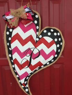 Cute Valentines Day Door Hanger! Made with a canvas front and a burlap back. Hand painted in three different designs. Monogrammed with your