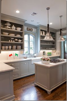 grey tones in kitchen // open shelving