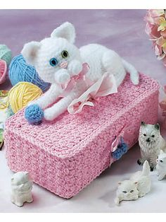 Ravelry: Cat & Ball Tissue Cover pattern by Judy Nelson.  Free pattern.  Sweet for a little girl!