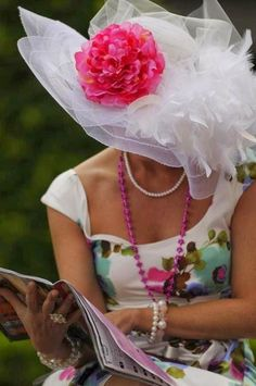 Wide Brimmed White Hat with White Feathers and Hot Pink Flower