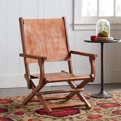 """FORD DIRECTOR'S CHAIR--The timeless style of a vegetable-tanned leather seat and back, with the ease and convenience of a wood, folding base. Handcrafted. Imported. Exclusive. 23-1/2""""W x 25""""D x 35""""H, seat 13""""H."""