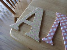 Want to create custom letter wall hangings without breaking the bank? Learn how to make these inexpensive DIY Cardboard Letters!