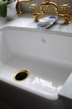 oh yes.....Carrera marble/ Shaw white porcelain sink/ brass bridge faucet & blue/white spode soap dish! Love it all!