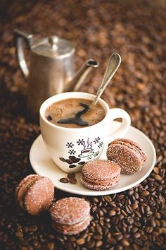 Coffee macarons with a cup of steaming coffee.. just divine.
