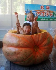 A boy and his grandfather sit in a hot spring bath made from a 229 kg pumpkin at a spa facility in Nyuzen town, in Japan's Toyama prefecture on December 19, 2010.