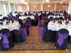 Regal Purple Bows on black chair covers available for rent - Special Event Linens