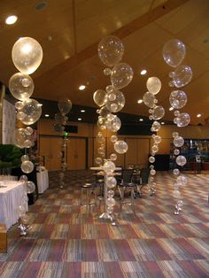 Bubble birthday decor idea -white balloons different sizes hung on a string