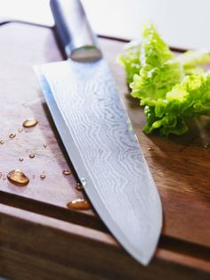 Gifts under $50 - SLITBAR chef's knife. With durable steel and a 25-year warranty, the cook may want to kiss you for getting them the perfect gift this holiday season!