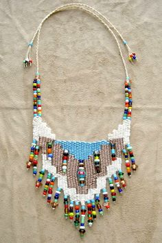 """Navajo"" - 2010 - Adjustable length, stairstep design, beads woven in, SOLD.  Two other necklaces were based on this design (Southwest and Southwest II) at a customer's request.  Hand woven, handwoven, weaving, weave, needleweaving, pin weaving, woven necklace, fashion necklace, wearable art, fashion necklace, fiber art."