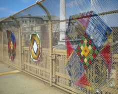 Yarn Bombing Graffiti Art: how to dress up an ugly fence