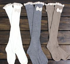 "Diamond Knit Knee High Boot socks with Frilly Lace and lace bow. You are bound to love these extra long boot socks, stretch up over the knee or wear scrunched down. Perfect with jeans, leggings or by themselves.  Cream-Mocha-Dark Grey-Black   Sizing:  One Size fits most   approx. 24"" long"