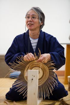Morigami Jin demonstrates the different steps of bamboo art making including…