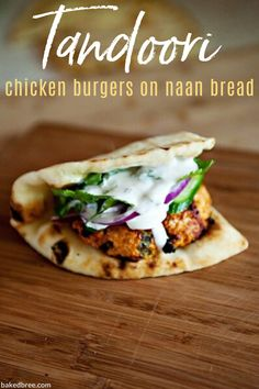 Tandoori Chicken Burgers - a tandoori chicken burger served on naan with a mint yogurt sauce and topped with cucumber, cilantro, and red onion. These are flavorful and delicious. Burger Recipes, Gourmet Recipes, Dinner Recipes, Healthy Recipes, Yummy Recipes, Recipies, Casadia Recipe, Tandori Chicken, Ground Chicken Burgers