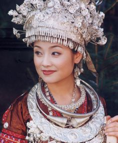 Miao girl. 苗族. The Miao is one of China's 56 ethnic groups. The traditional headdresses and necklaces are often in silver for girls.