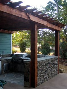 enclosed outdoor kitchen. Could build the half wall out of brick or cinderblocks(not as pretty) or even use prefab picket fence sections. @ its-a-green-life