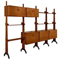 Italian Wall Console in Teak with  Brass Details, Italy 50's   From a unique collection of antique and modern shelves at http://www.1stdibs.com/furniture/storage-case-pieces/shelves/