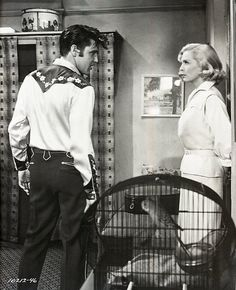 Elvis Presley as Deke Rivers and Lizabeth Scott as Glenda Markle in LOVING YOU (Paramount Pictures), 1957. And also please take notice of Matilda, the green and gold Aussie Budgie. ;-)  Elvis's second movie was filmed in technicolor from January 14 to March 16, 1957.