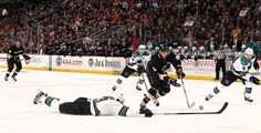 Bobby Ryan of Anaheim and Douglas Murray of San Jose battle for the puck  2-4-13