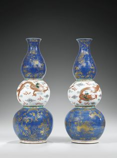 A PAIR OF FAMILLE VERTE AND GILT-DECORATED POWDER-BLUE TRIPLE-GOURD VASES, QING DYNASTY, 19TH CENTURY