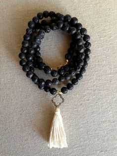 Lava Bead and Diamond Clover Tassel Necklace by Goldenstrand Jewelry