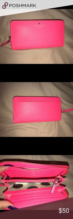 Kate Spade bright pink Wallet Slightly used. No tears/marks. kate spade Bags Wallets