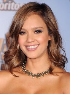 """The 10 Sexiest Haircuts for Oval Faces: SHOULDER-LENGTH WAVES  """"The length of this simple, tousled look suits Jessica Alba's shape very well,"""" says Babaii. Her waves add volume and draw out her cheekbones—which makes an oval face look slightly more rounded, rather than further lengthening it. To make waves work on fine hair, add volume with Pantene Triple Action Volume Mousse at the roots."""