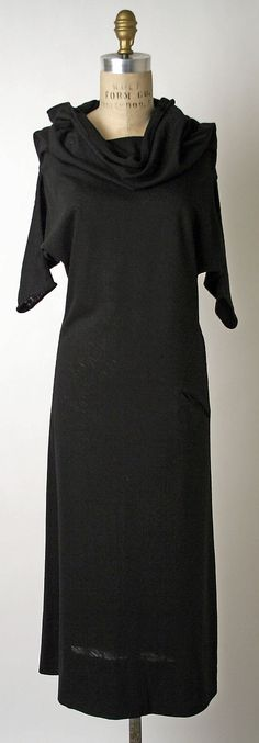 Wool dress, 1952, Claire McCardell. Appears to be cut of two large pieces of wool jersey (one in front and one in back) with that chic slash pocket on the hip. So far ahead of the curve!