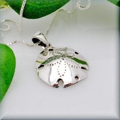 My most favorite thing ever in sterling silver! Must have!  Sand Dollar Necklace Ocean Necklace Beach Jewelry Sanddollar Sterling Silver Pendant (SN551) by BonnyJewelry on Etsy https://www.etsy.com/listing/53416776/sand-dollar-necklace-ocean-necklace