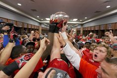 Badgers in the locker room celebrate their Big Ten Championship victory over Nebraska. University Of Wisconsin Football, Wisconsin Badgers, Rose Bowl, Nebraska, Victorious, Photo And Video, Celebrities, Locker, Congratulations