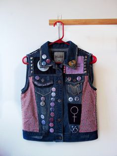 This is a new Mudd vest that i modified  Size Medium    I worked really hard on this making it cute and fierce. It has A LOT of awesome decor and