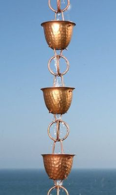 Hammered Cup with Ring Rain Chain by Rain Chains Direct. $89.95. Our Hammered Cup rain chain is one of our newer chains and already it has proven to be one of our most popular rain chains. It is an elegant, yet functional design. Each cup has an intricate hammered surface pattern. All cups have a hollow bottom so that water can flow through the rain chain, from cup to cup, as it is guided gently to the ground. This assemblage will develop a beautiful rustic patina over time.