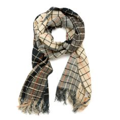 The Co-Op Wool and Silk Scarf is a celebration of ancient artisanal practices. Hand-loomed in Uttarakhand, India, the fabric is a luxurious blend of Himalayan merino goat wool and environmentally friendly eri silk. In tasteful fall colors, this scarf is great in both stripes and checks.