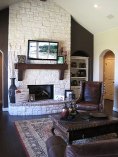 Great fireplace along with a tall ceiling and wood beams!