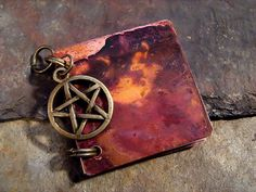 Copper Book Pendant with Six Blank Pages for Journaling, Painting, or Spellbinding. $26.00, via Etsy.