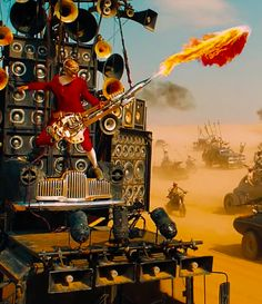 "The Insane, Flame-Throwing Guitarist Who Steals ""Mad Max: Fury Road"""