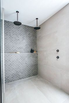 If I could design every bathroom with a long shower ledge instead of shampoo niches, I would be such a happy camper! Line up all those shampoos in this dream bathroom idea for a walk-in shower