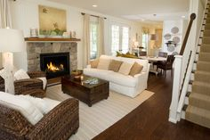 Similar floor plan but the fireplace moves to behind the chairs and windows replace where the fireplace is here