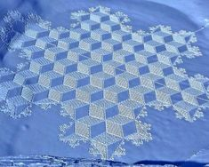 Simon Beck's snow art:  Artist Simon Beck carves geometric designs into snowy landscapes