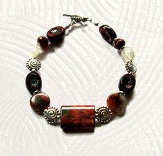 Maggies Beadery womens 8 1/2 inch brown Jasper and Quartz bracelet. This closes with a small sterling silver toggle clasp.