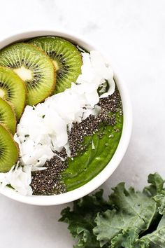 A simple low-sugar green smoothie bowl with healthy ingredients including leafy greens, nut butter, coconut flakes, banana, and chia seeds. | www.honestlynourished.com