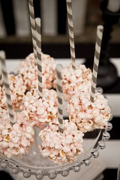 Pink popcorn balls on stripey straws- could use with rice krispy treats too!