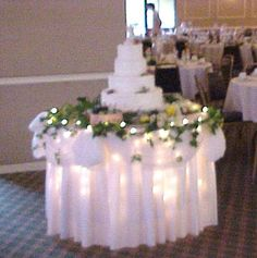 icicle lights under organza and over white tableclothlovely