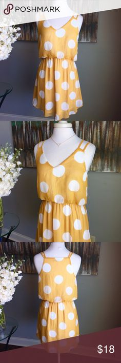 Mustard yellow and white polka dot summer dress CALS Dress - size large - 33.5 inches long - mustard yellow and large white polka dots - fully lined - elastic waist - v neck abs double spaghetti straps - excellent condition - triangle necklace for sale in my closet - reasonable offers welcomed and bundle discount available cals Dresses