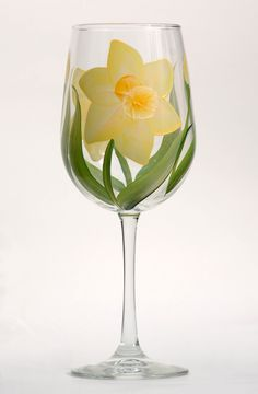Daffodils hand painted wine glass http://www.wineflowersglass.com/collections/wineglasses/products/daffodils $19.95