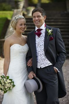 Grey Morning Suit with Burgundy Kravat --- i am in LOVE with his tux oh my god. future husband will be wearing this
